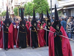 Robed participants in the colors of the Parroquia Nuestra Señora de los Ángeles