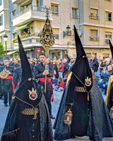 Robed participants in the colors of the Parroquia Nuestra Señora de los Ángeles