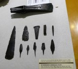 A collection of iron and bronze objects (spearheads, daggers, needles and a chisel)