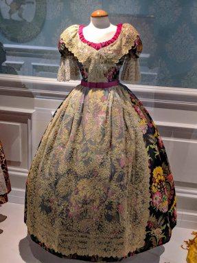 Traditional silk dress of Spanish Falleras women.