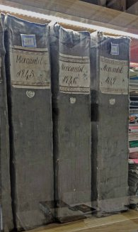 Actual books, behind glass, from the Historical Archive