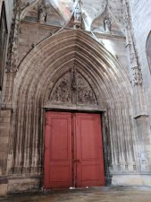 The Archivolt and Tympanum over red doors