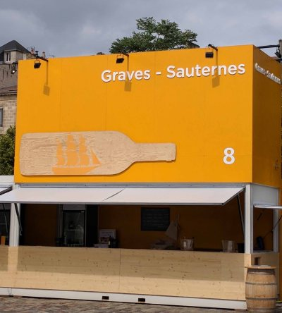 Wine Tasting Booth providing tastings of wine from the Graves - Sauternes region.