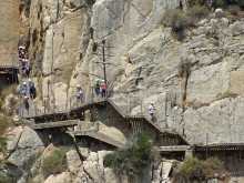 Visitors navigating the stairs of the boardwalk along the Gaitanejo Gorge