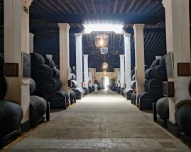 One of the many storerooms at Bodegas Gonzalez-Byass. In total over 100,000 barrels of wine, in different stages of production, are kept in the company warehouses.