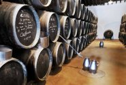 A multi-level 'Soleras' at Bodegas Lustau made up of at least three levels (probably more) and potentially hundreds of casks in each level. In the aisle are two arroba-sized (a specific unit of measurement) pitchers that were used to carry sherry from one criadera to another in the days before pumps.