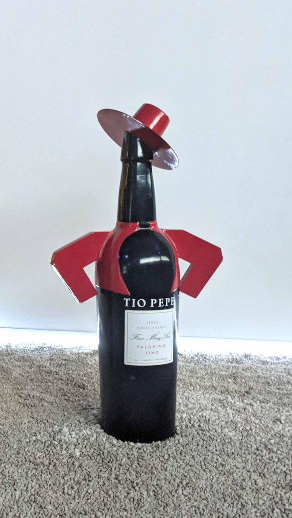 A bottle of Tio Pepe Fino, a style of Sherry that is aged entirely under flor (layer of yeast), and therefore not oxidized. Finos are dry, golden in color, and best served cold.