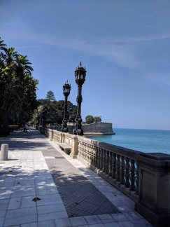 The seawall with the intricate looking lamp posts