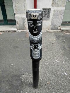 A painted street bollard on one of the back streets of Grenoble